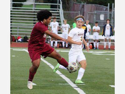 Saline Clips Dexter in District Soccer Opener
